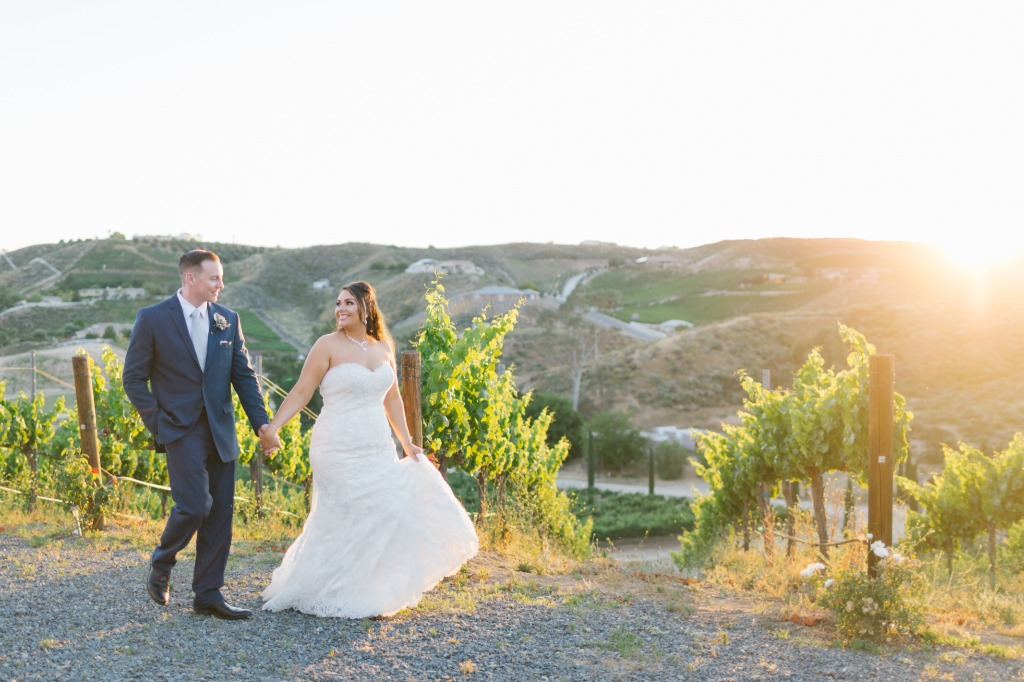 Obsessed with the golden sunset light as these two strolled the vineyard where they got married! Always worth getting whisked away