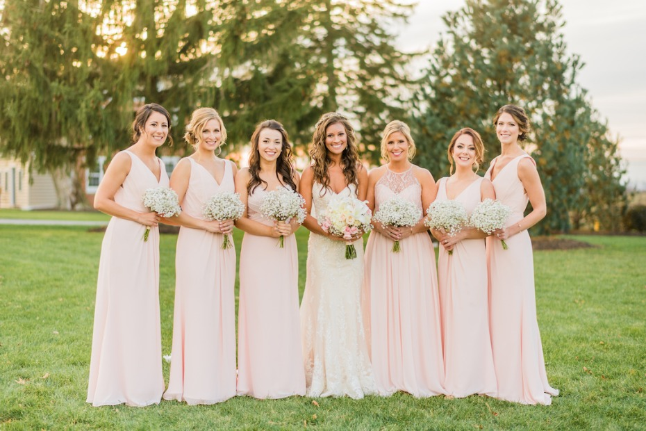 Blush bridesmaid dresses with babys breath bouquets