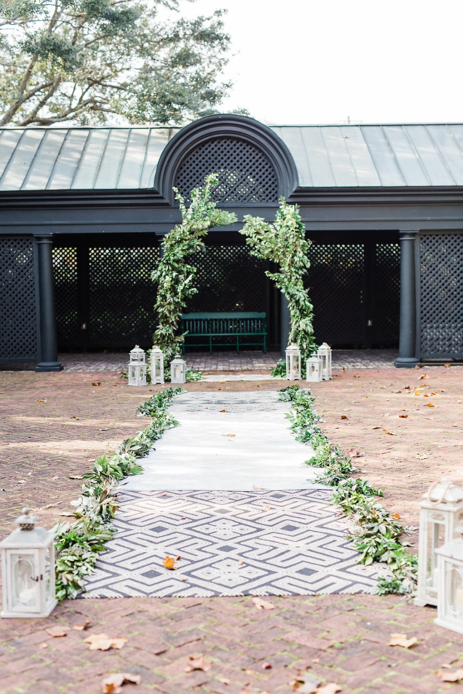 Greenery ceremony with rug aisle