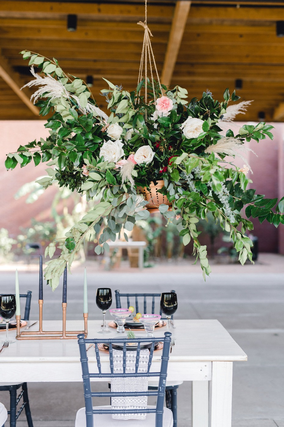 Use hanging arrangements over the reception table