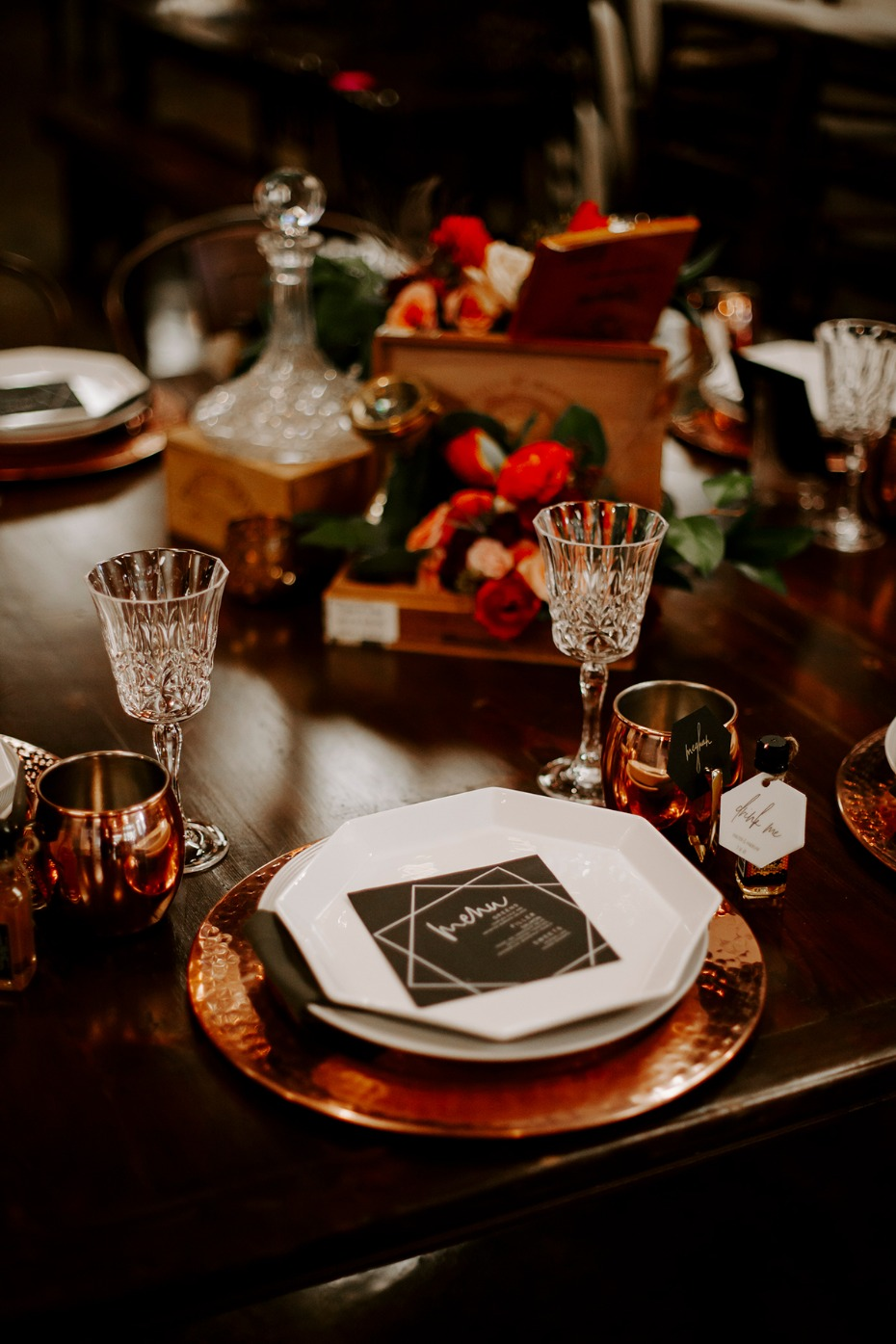 copper and black table setting