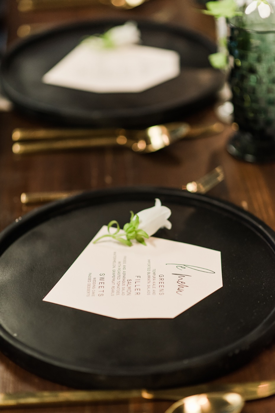 black and gold table place setting