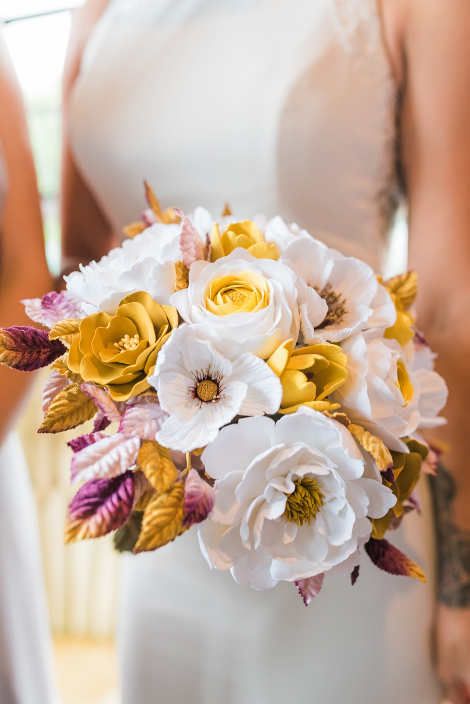 wedding bouquet in gold white and purple