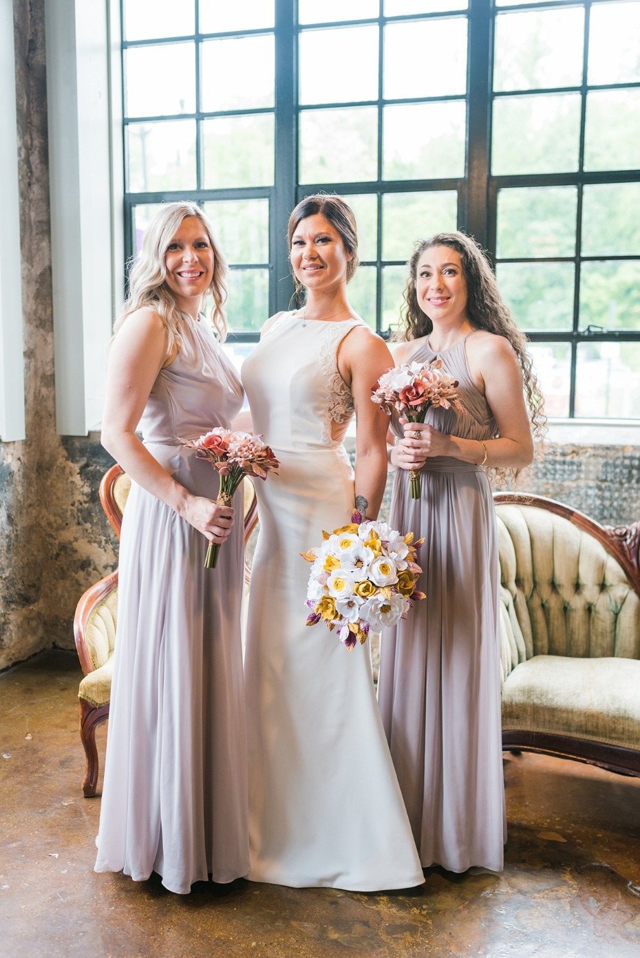 bridesmaids in soft purple dresses
