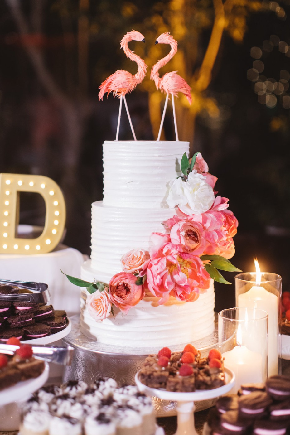 Wedding cake with flamingo toppers
