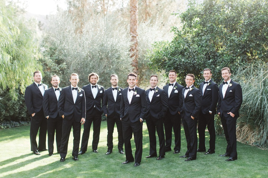Matching groomsmen in tuxes