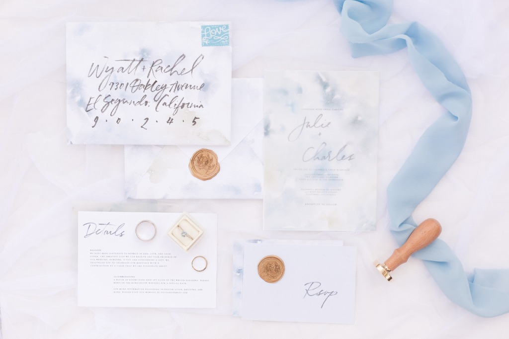 This dreamy blue watercolor invitation suite is simple yet stylish with its modern hand calligraphy. A perfect soft touch to a light
