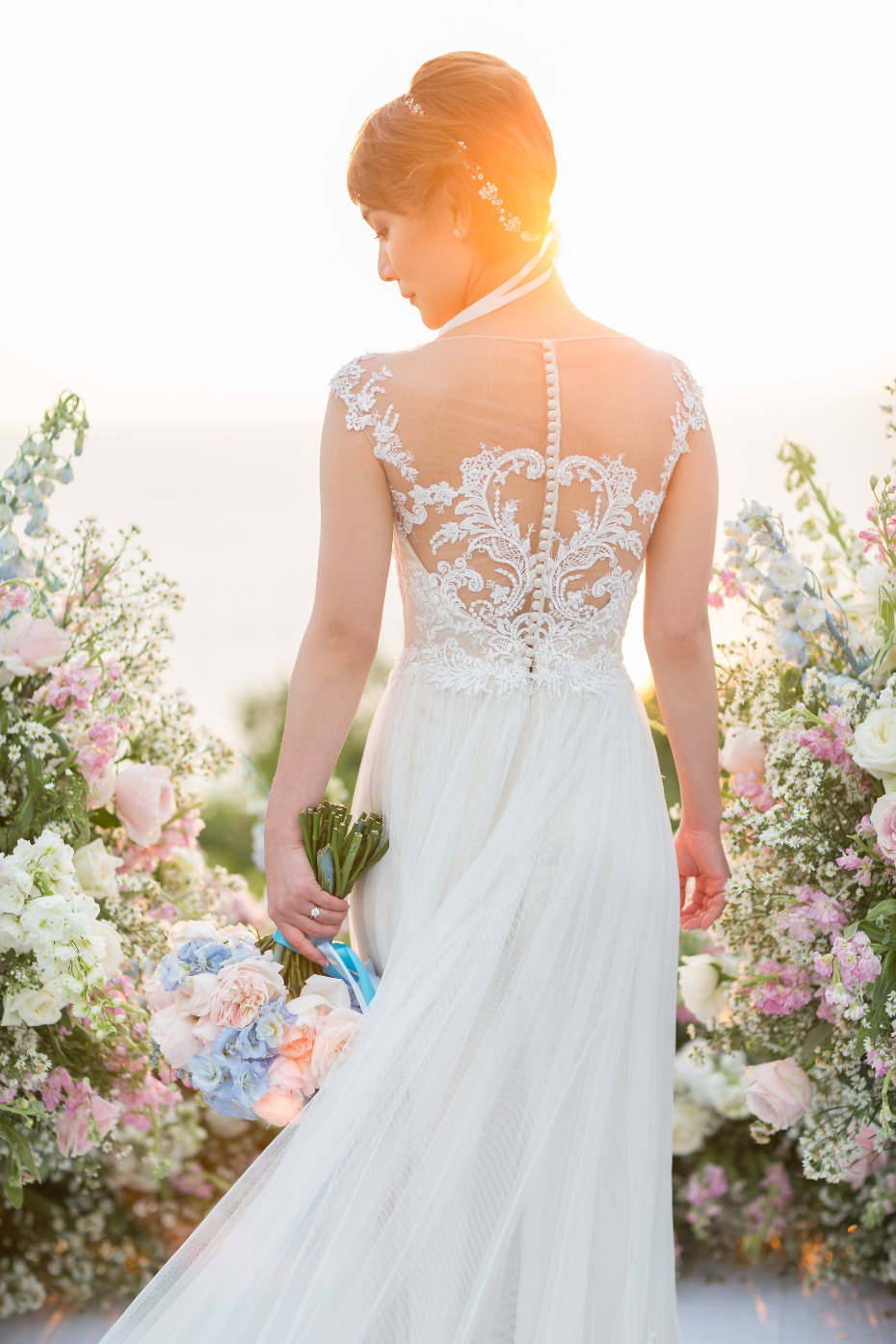 Elegant lace back wedding gown by Lusan Mandongus