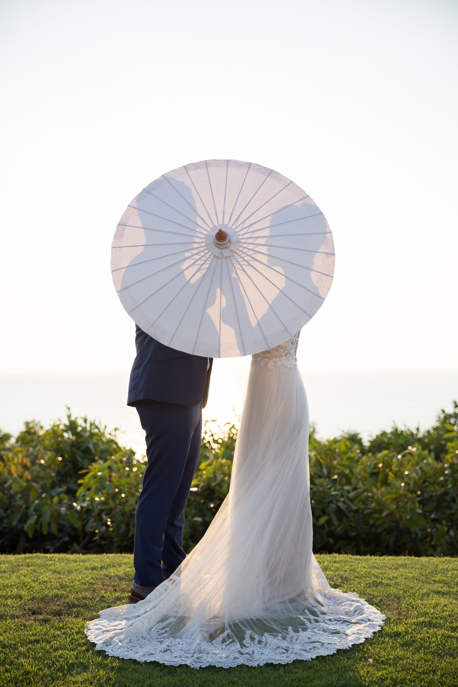 Cute parasol portrait for the bride and groom
