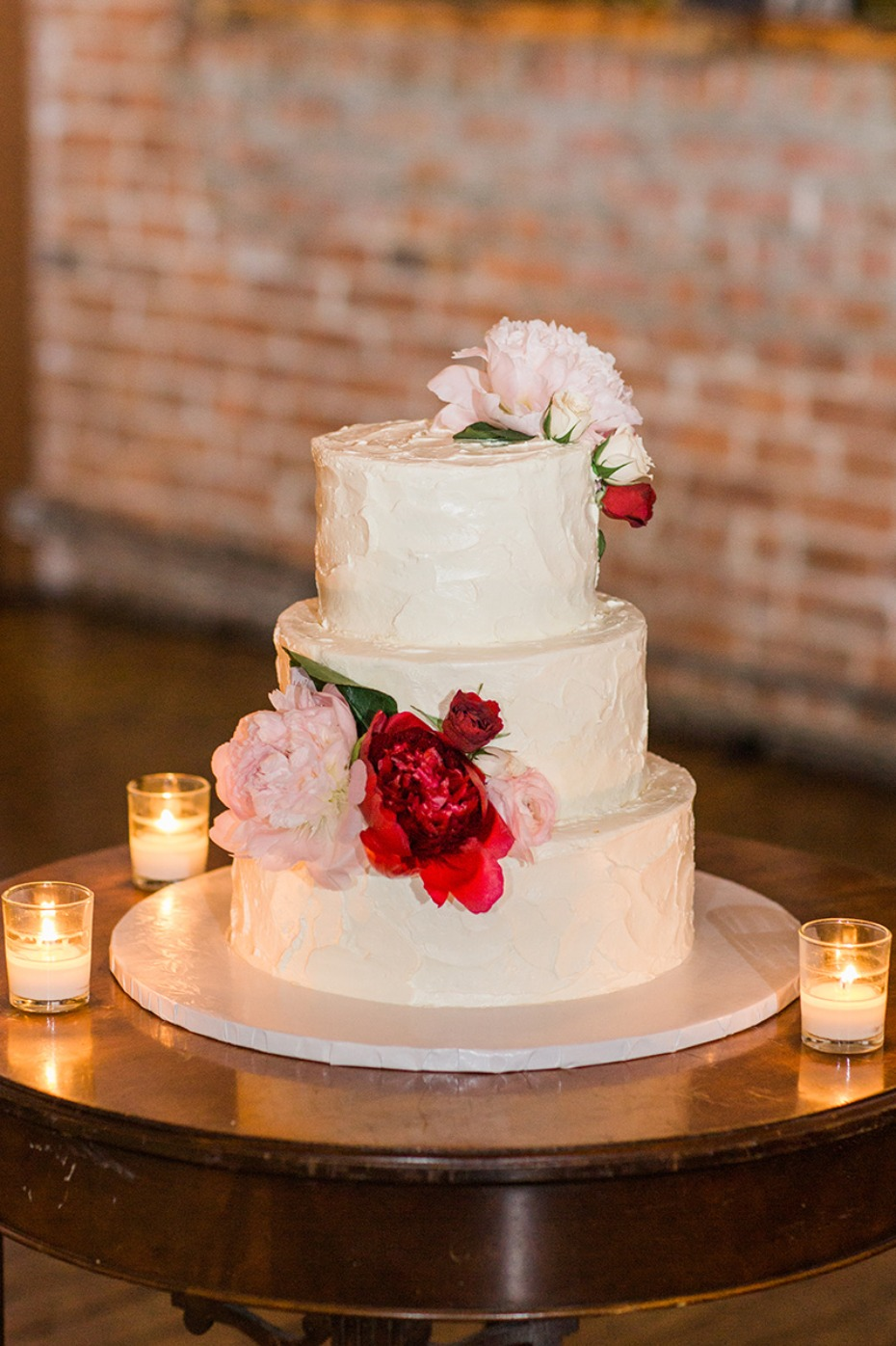 classic floral topped wedding cake
