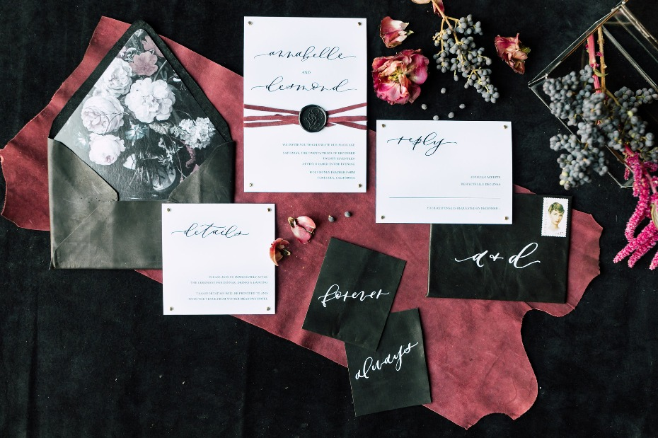 Leather and floral invitation suite
