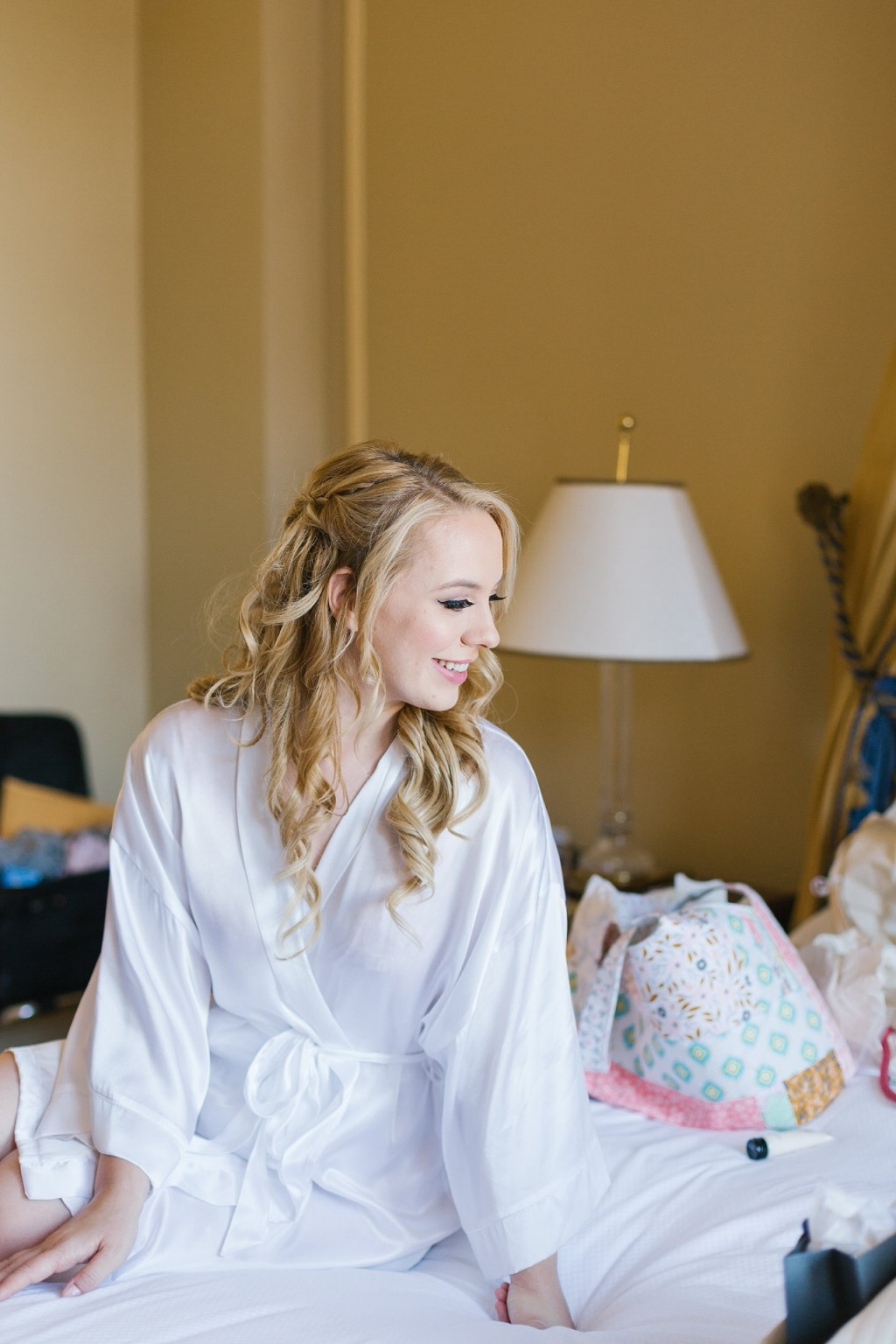 Bride looking gorgeous just before getting dressed! Love the while silk robe too!