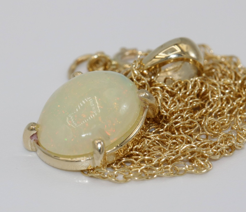 Opal pendant necklace made in USA. Set in 14k yellow solid gold.