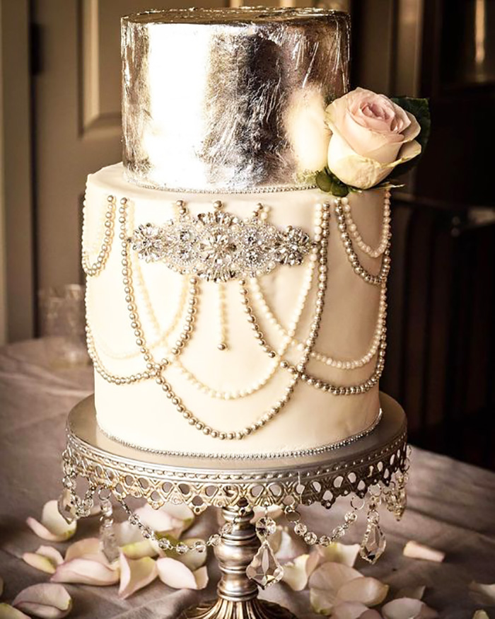 Silver leaf, edible dragees, and rhinestones. Loved this bling-y wedding cake by The Cake Flower on an antique silver chandelier cake