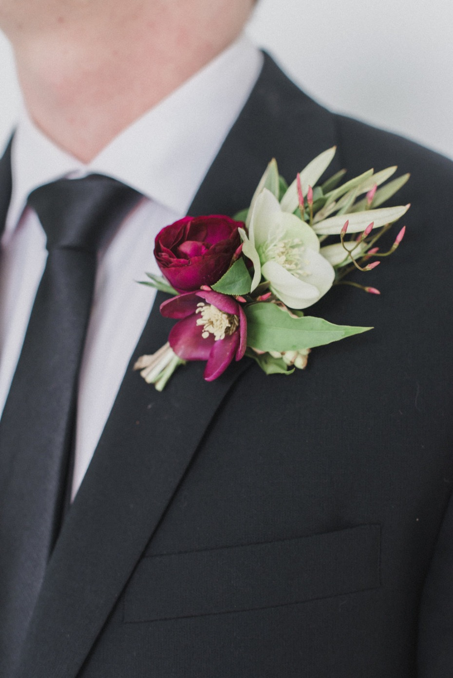 Maroon and white floral boutonniere