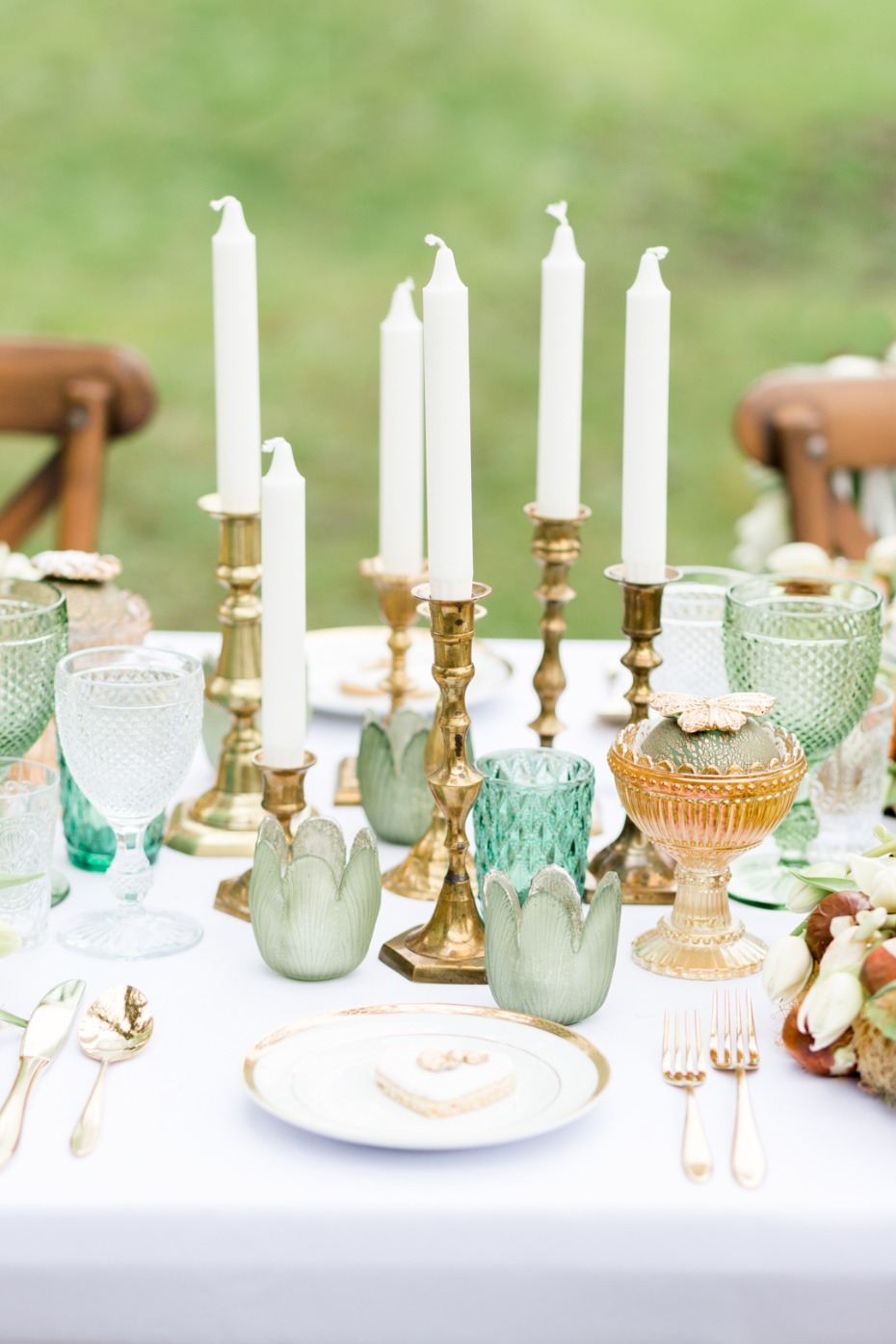 Brass candle sticks and colored glassware