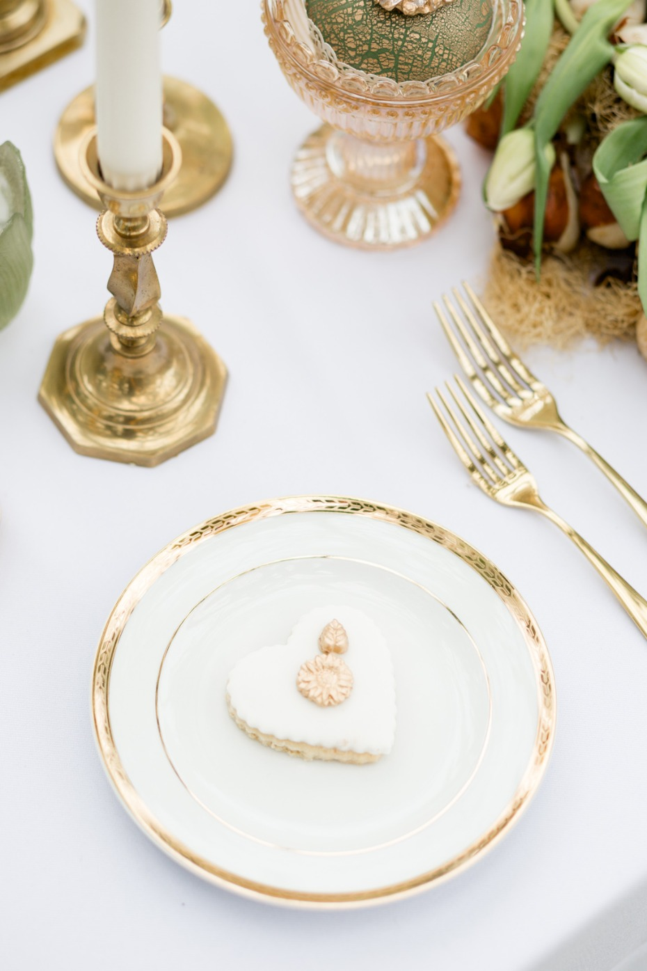 Gold-rimmed plates for a wedding