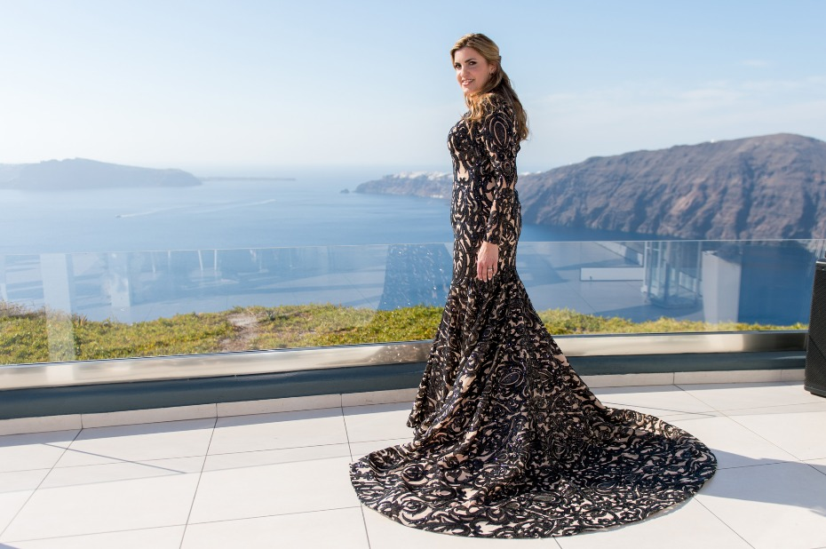 wedding guest in black floor length wedding dress