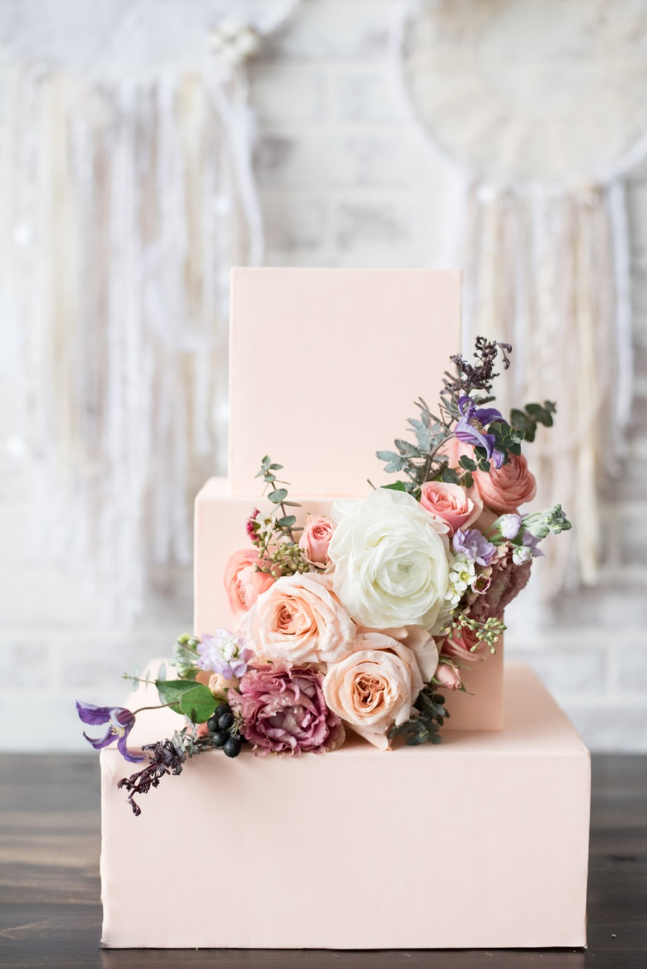 Blush square wedding cake with flowers