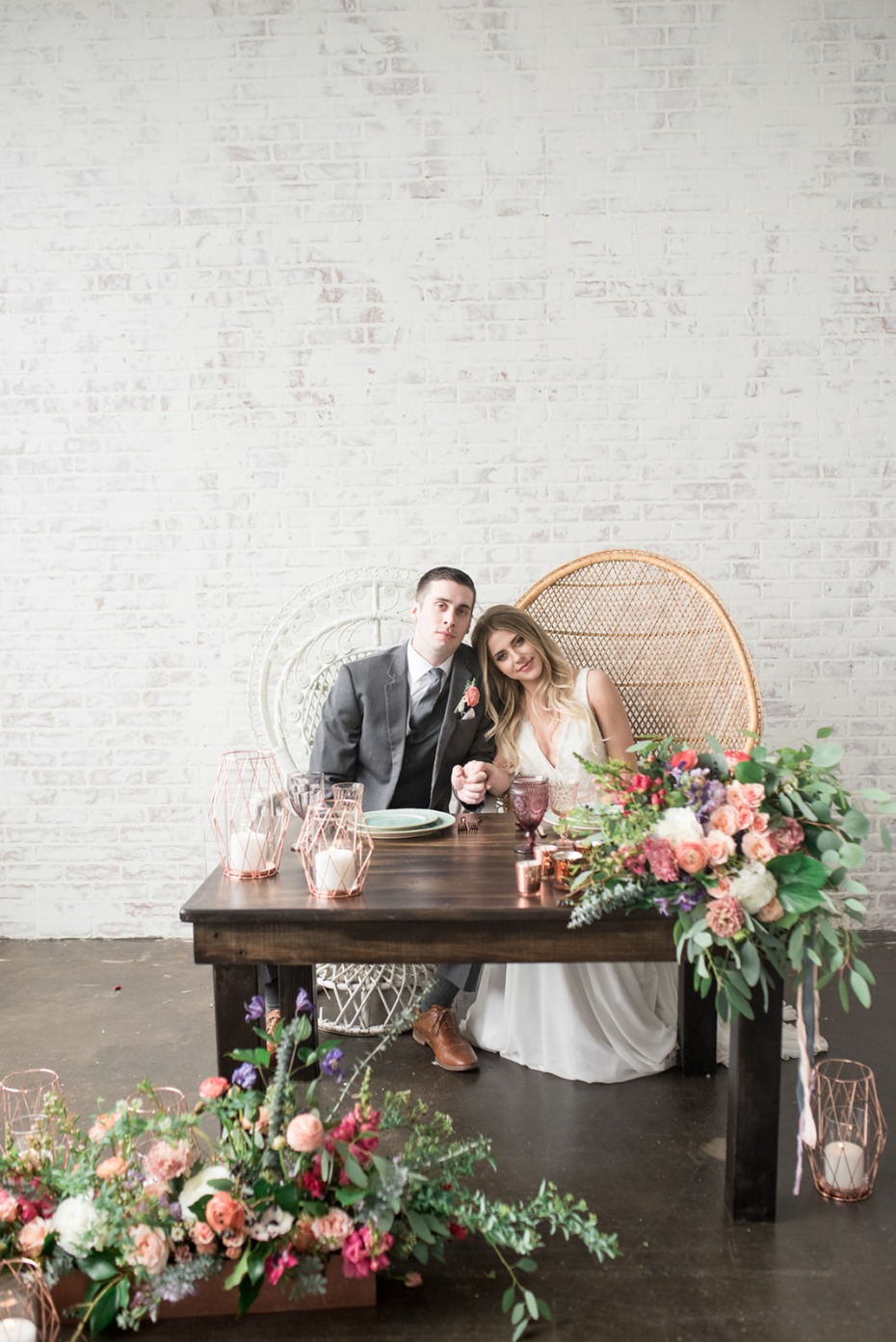 Bohemian sweetheart table with peacock chairs