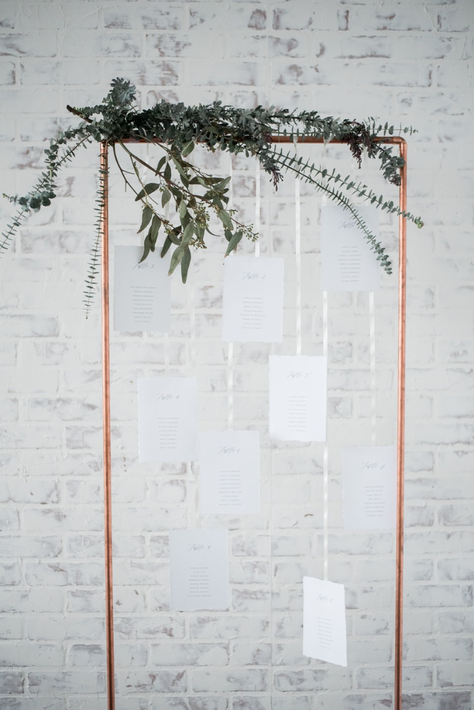 Hanging seating chart made of copper