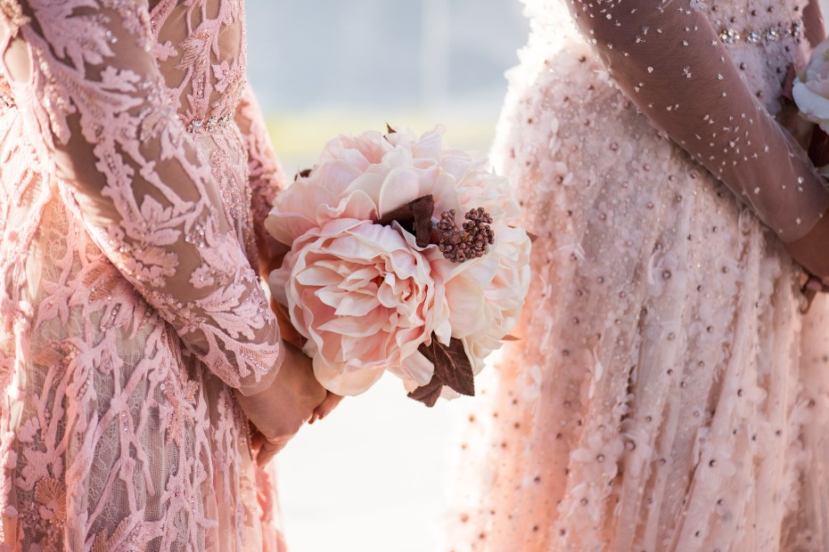 bridesmaid holding pink wedding bouquet