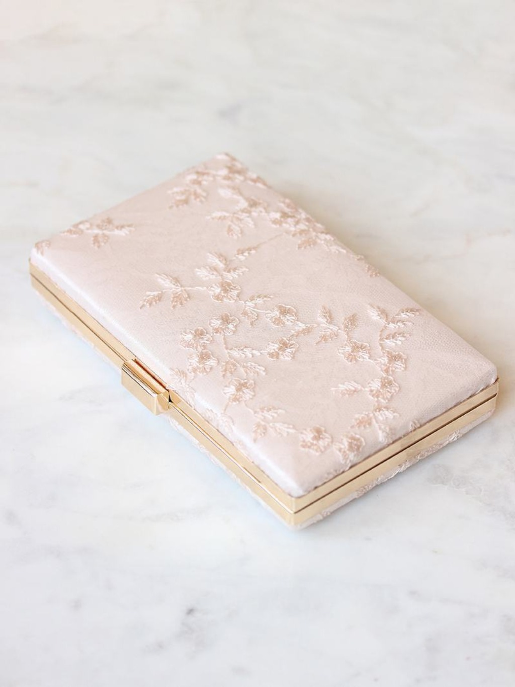 Darling, feminine lace on a blushy satin cover. Refined clutches for any occasion.