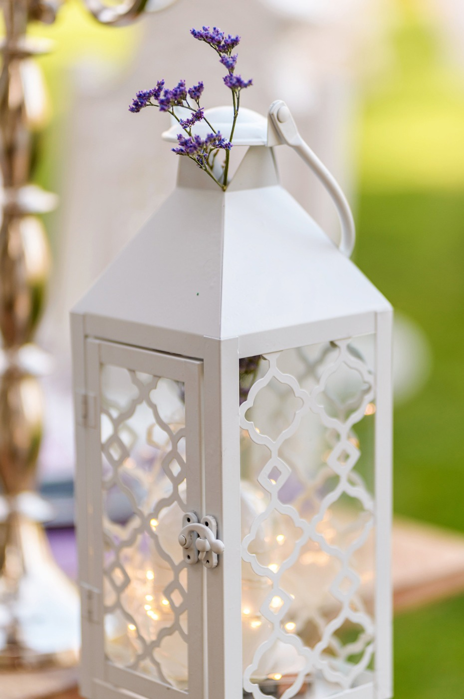 romantic white lantern with a sprig of lavender