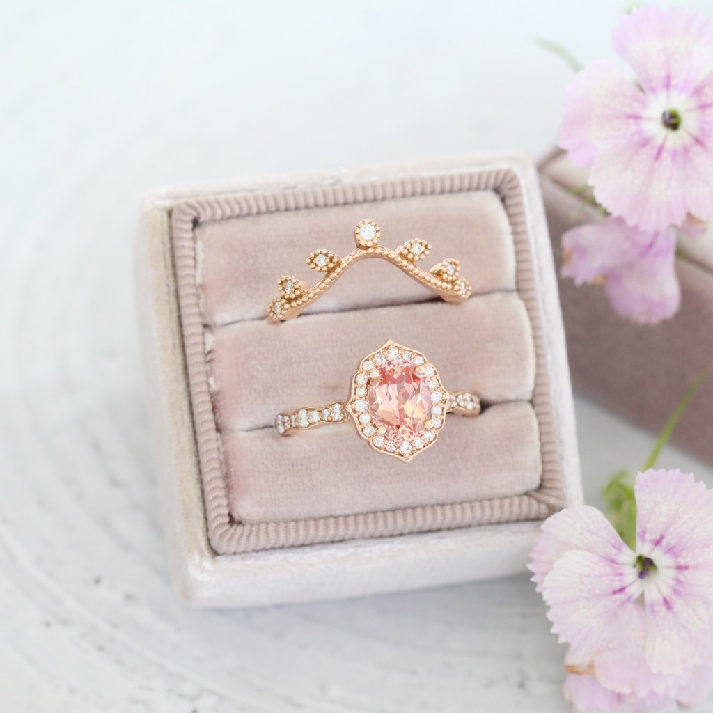 The floral vibes in this photo are screaming SPRINGTIME ~ See more from our Peach Sapphire engagement ring and bridal set collection