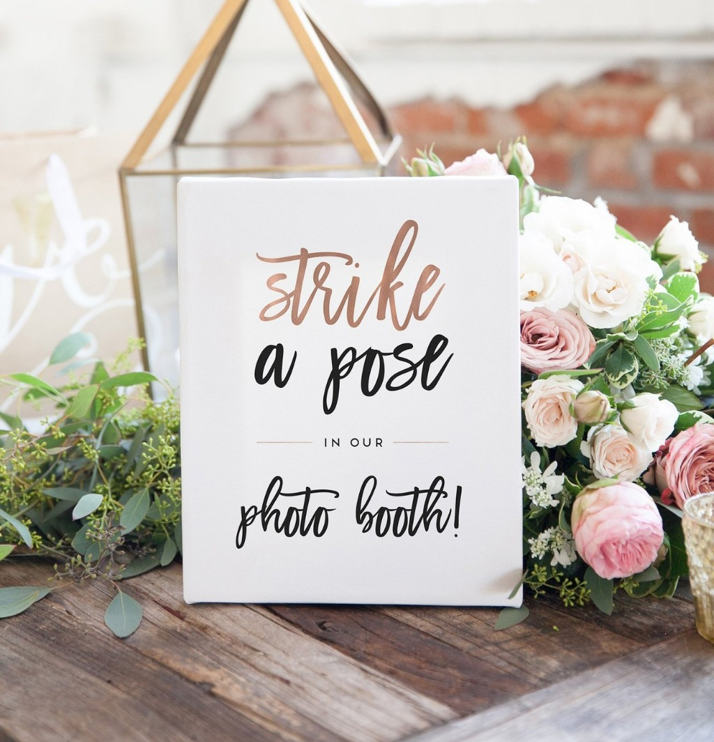 Every photo booth needs a cute sign, and this one from Miss Design Berry tells your guests to 'Strike a Pose' for your photo booth