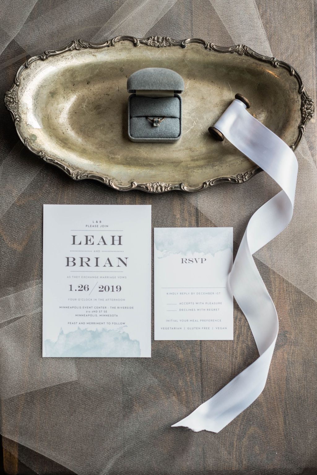Choose your wedding colors and showcase them with a subtle watercolor wash wedding invite like this Modern Gold design in blue.