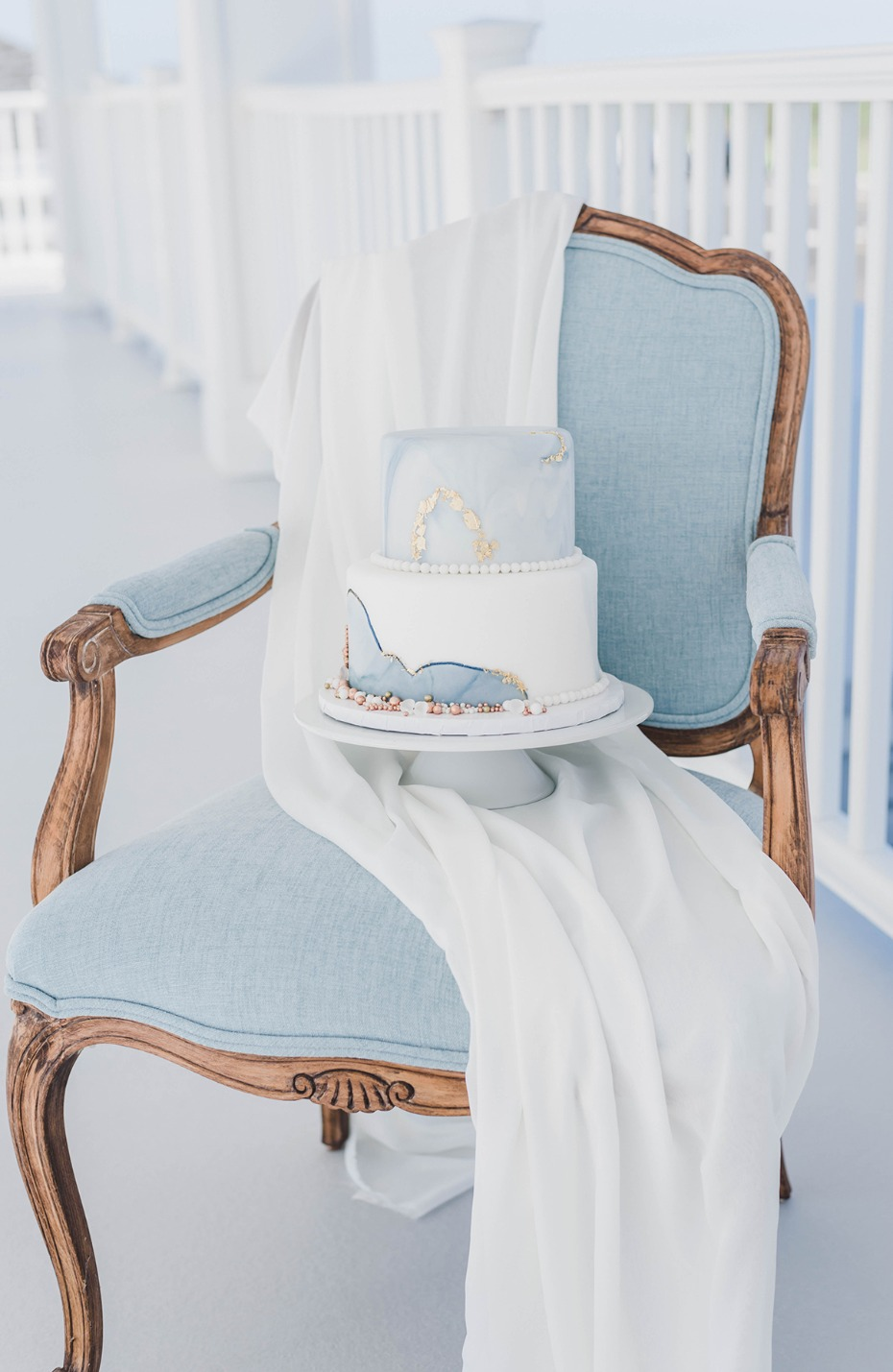 blue and white marbled wedding cake
