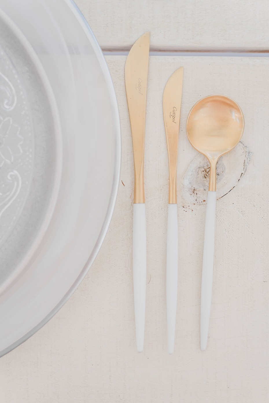 gold and white modern silverware