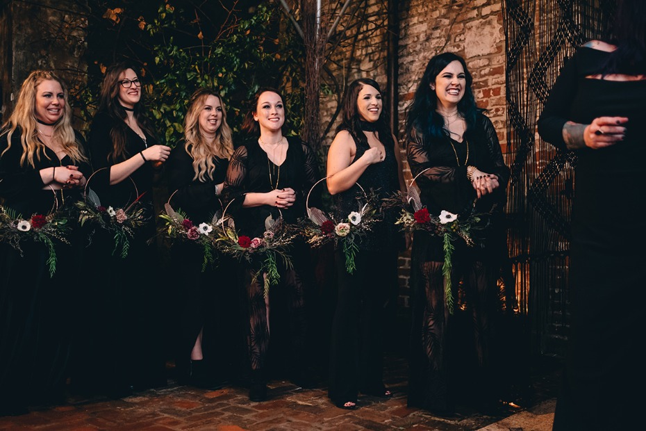 bridesmaids in black with hoop bouquets