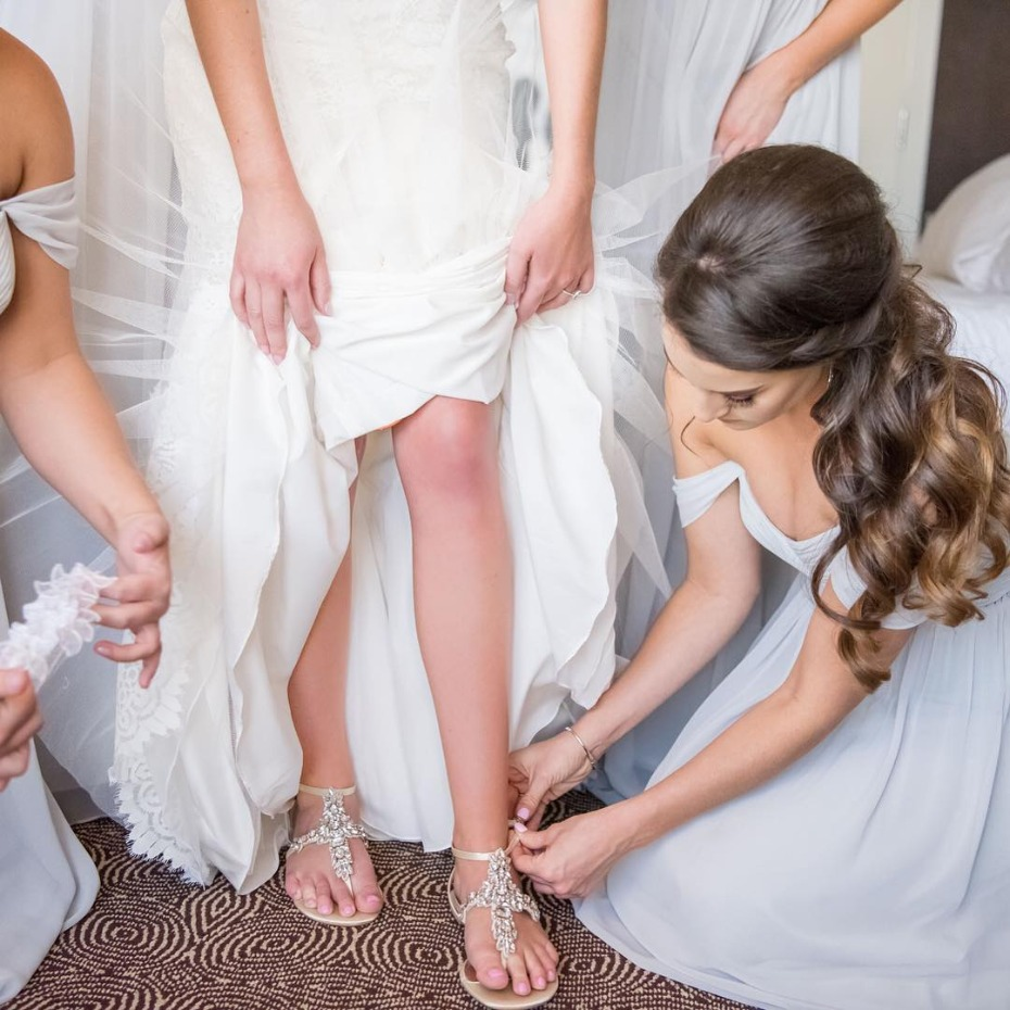 Putting on the bride's shoes and garter