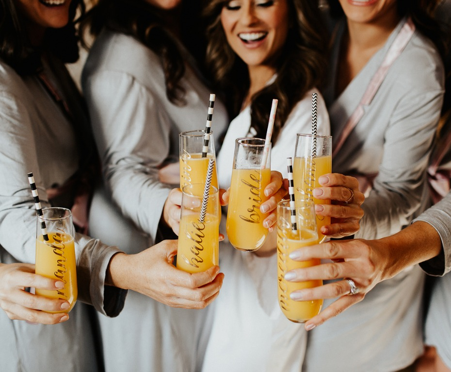 Cheers with the bride and bridesmaids