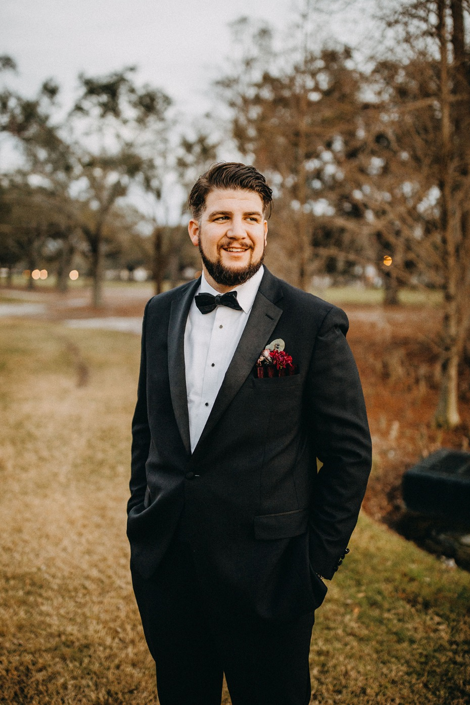 groom in classic black tie