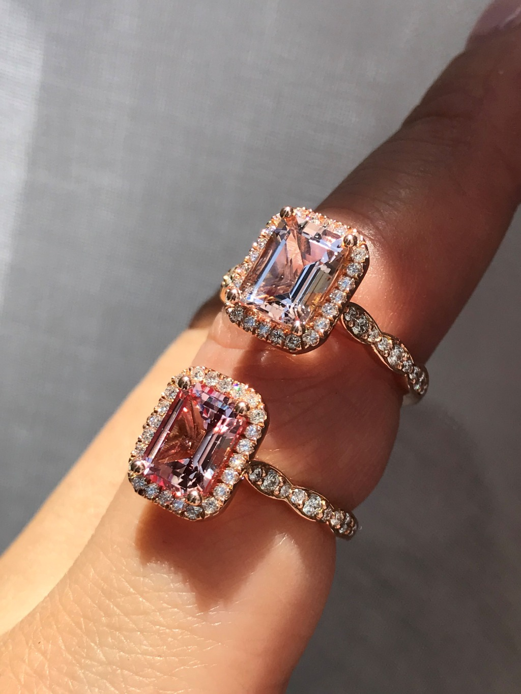 Our newest Emerald Cut additions! Morganite on top, and Champagne Peach Sapphire below, both in scalloped diamond band in Rose Gold