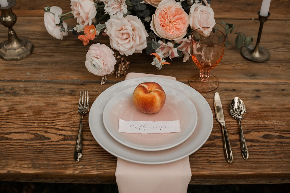 Rustic wedding table with peaches
