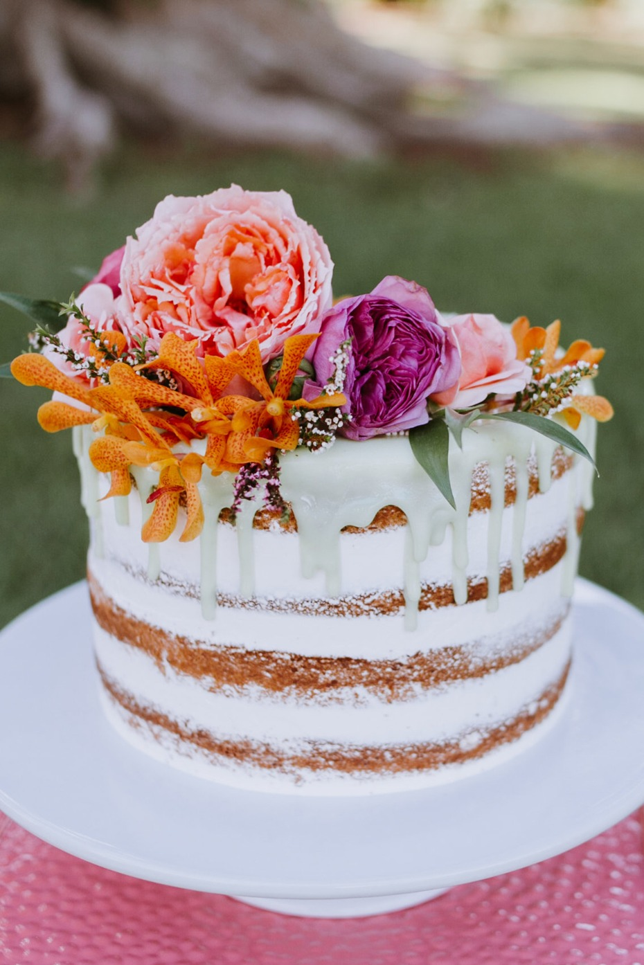 nearly naked drizzle tropical themed wedding cake