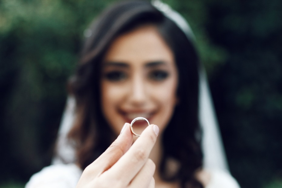 Bride Holding a Ring Photo by Soroush Karimi