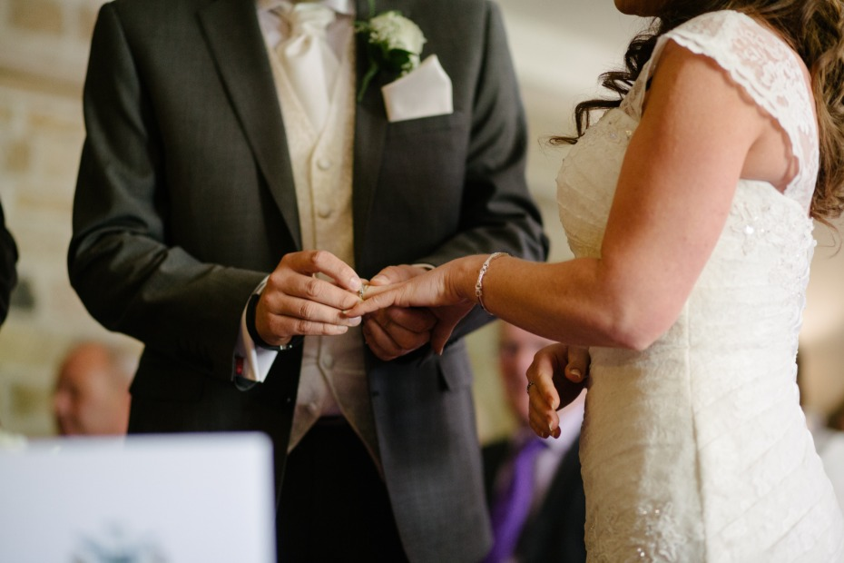 Couple Exchanging vows Photo by James Bold