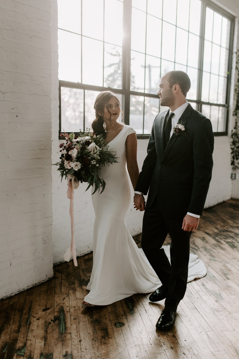 Couple walking into their reception Photo by mikayla-herrick