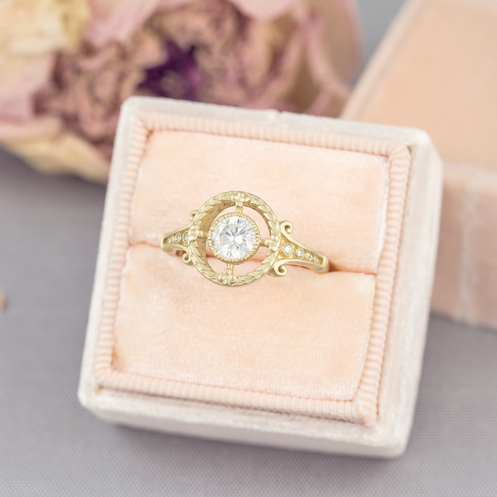 This little Art Deco beauty is our new Emmaline Ring. It has romantic swirls, a laural wreath and tiny daisies. Delicate diamonds trail