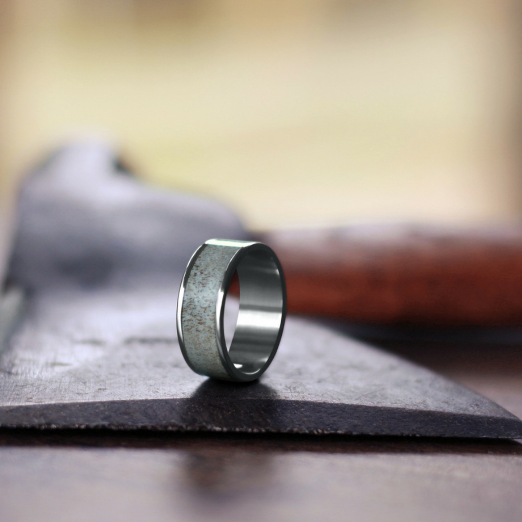 Men's deer antler titanium wedding ring. This ring is made out of real deer antler and is handcrafted in the U.S.A