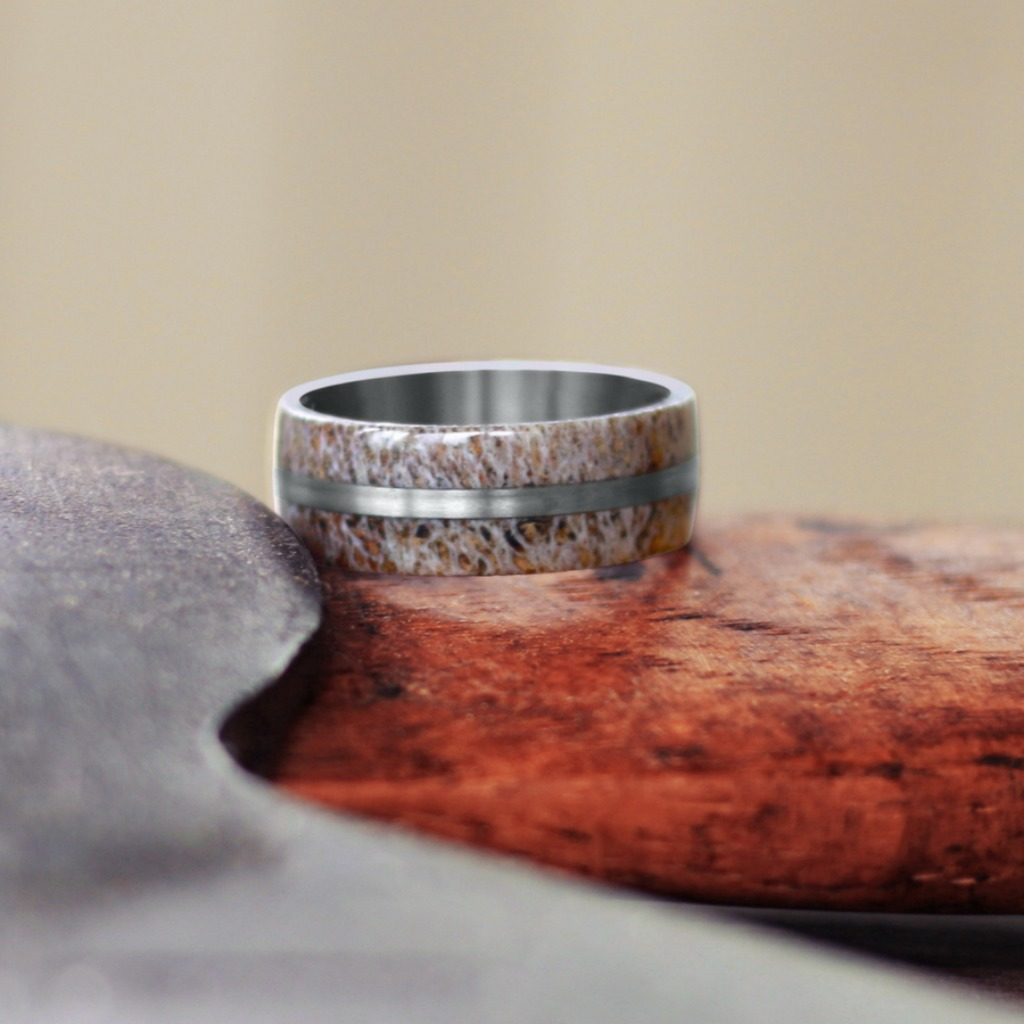 Handcrafted in the U.S.A, this deer antler rings features a titanium center stripe. Does your future husband have some deer antler