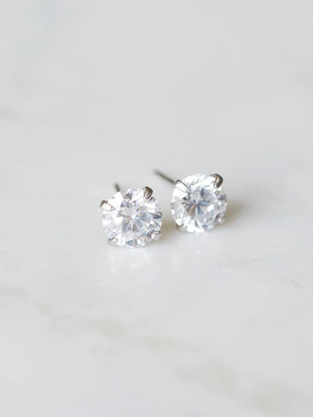 The Zaira Earrings are cubic zirconia mounted on sterling silver posts. They shine beautifully, are made to last—and they're only