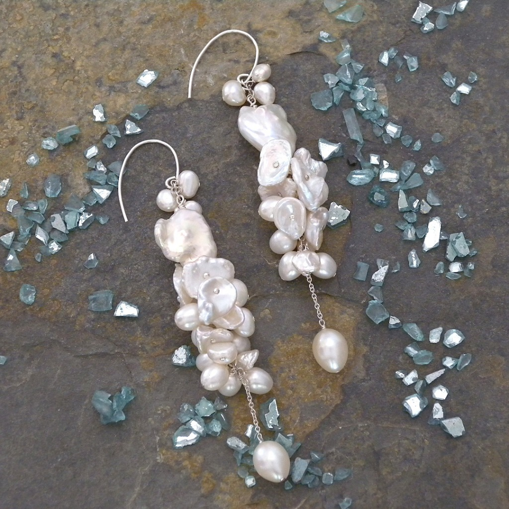 Organic pearl chandelier earrings. Cluster of Keishi pearls and Freshwater pearls finished with an oval pearl dangle. Fabulous for