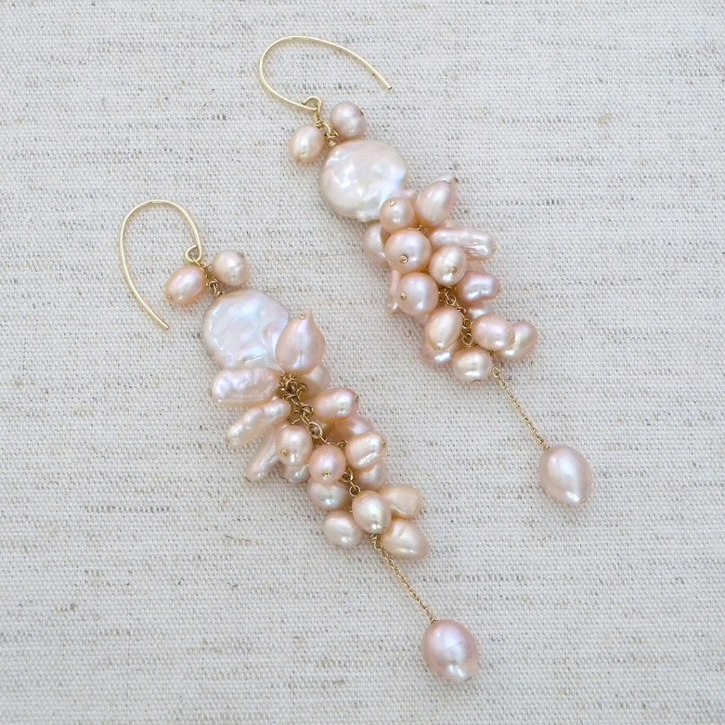 Organic pink pearl chandelier earrings. Cluster of Keishi pearls and Freshwater pearls finished with an oval pearl dangle. Fabulous