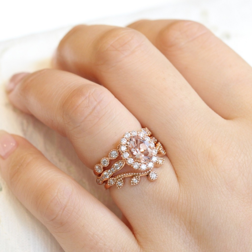 Love the look of this oval morganite engagement ring in a trio ring stack like this! Shop for your dream morganite engagement ring